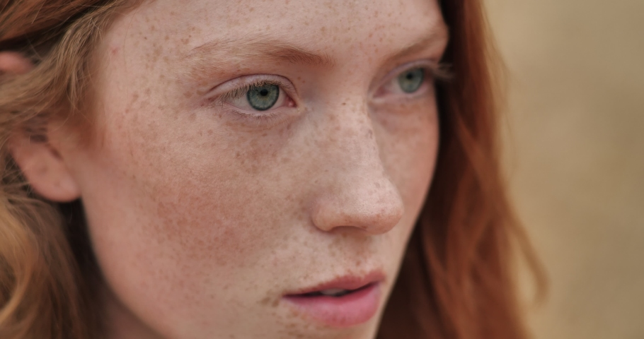 Close up of Woman's Face, Girl opening her Beautiful blue Eyes, Attractive Ginger. Natural Beauty with Freckles. Gorgeous woman with long Eyelashes and Attractive Appearance. Slow motion. Royalty-Free Stock Footage #1058021584