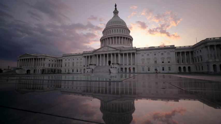 The US Capitol building in Washington, D.C. at sunset. Royalty-Free Stock Footage #1058051812