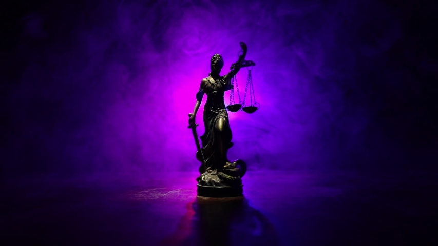 Law concept. Miniature colorful artwork decoration with fog and backlight. The Statue of Justice - lady justice or Iustitia / Justitia the Roman goddess of Justice. Selective focus | Shutterstock HD Video #1058062027