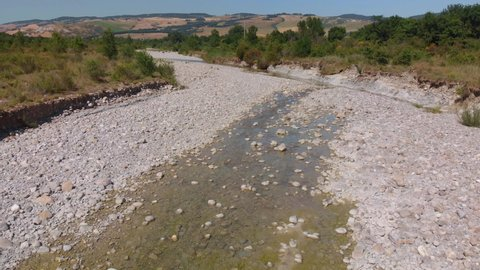 Aerial flight over river that is drying up in Europe.