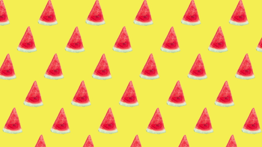 seamless pattern with many red ripe watermelon slices animated on a yellow background. realistic 3d food. advertising concept with copy space Royalty-Free Stock Footage #1058076526
