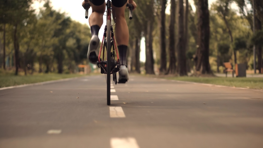 Triathlete Cyclist Training On Bicycle.Fit Athlete Workout Training Cycling For Triathlon Competition.Sport Recreation Concept.Cyclist Fitness Riding On Road Bike For Triathlon.Hard Cycling Workout Royalty-Free Stock Footage #1058108644