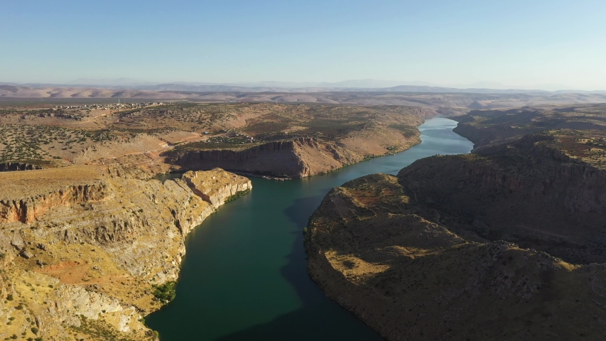 Halfeti is a small farming district on the east bank of the river Euphrates in Şanlıurfa Province in Turkey, 120 km from the city of Şanlıurfa. Royalty-Free Stock Footage #1058119081