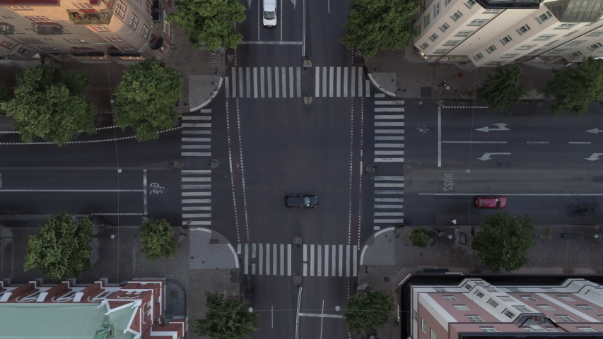 Aerial top down view of street in Stockholm, Sweden. Drone shot flying up over intersection and buildings Royalty-Free Stock Footage #1058127847