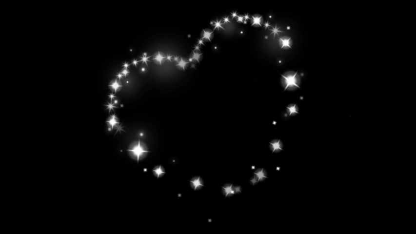 White light sparkling particles hearts shape on a black background. | Shutterstock HD Video #1058157751