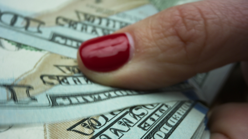 Macro shot businesswoman hands holding US money banknotes of new 100 dollars. Female cashier counting american dollars cash money. Closeup rich woman enjoying dollar banknotes in hands | Shutterstock HD Video #1058162305