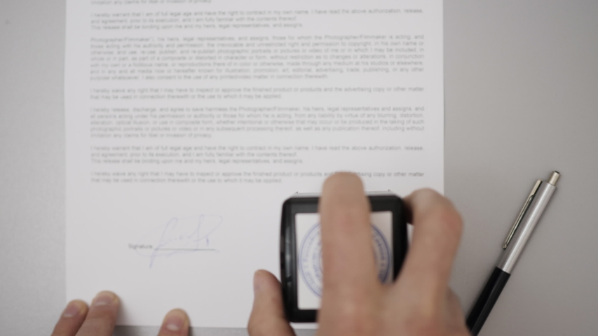 Businessman Stamping Document, Director Approving Contract, Paperwork. Notary Public in Office Stamping Document. Man Signing Credit Bank Contract. Legal Agreement. Filling out Contract on Paper. Royalty-Free Stock Footage #1058163901