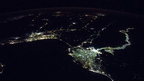 ISS Time-lapse Video of Earth seen from the International Space Station with dark sky and city lights at night over Nile , Time Lapse 1080p. Images courtesy of NASA.