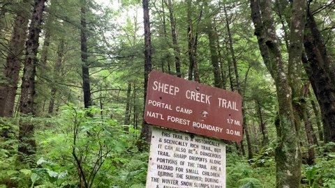 Danger warning sign on hiking trail