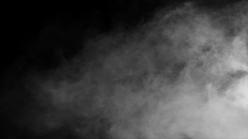 Abstract white smoke in slow motion. Smoke, Cloud of cold fog in light spot background. Light, white, fog, cloud, black background, 4k, ice smoke cloud. Floating fog.