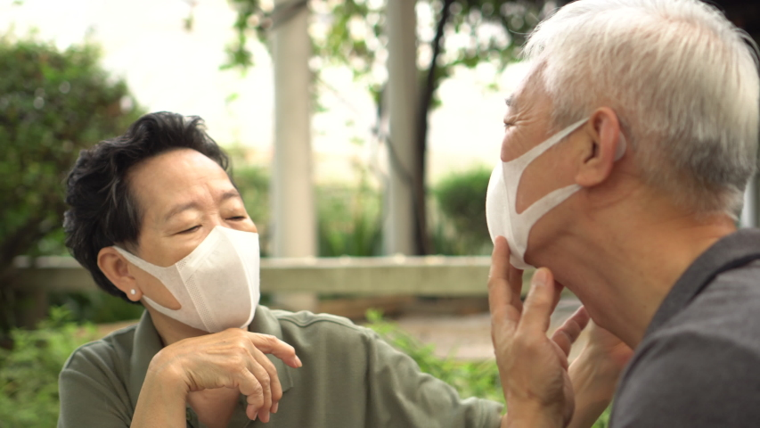Asian elder senior couple wife give mask for husband to wear during pandemic covid sesitive time Royalty-Free Stock Footage #1058214409