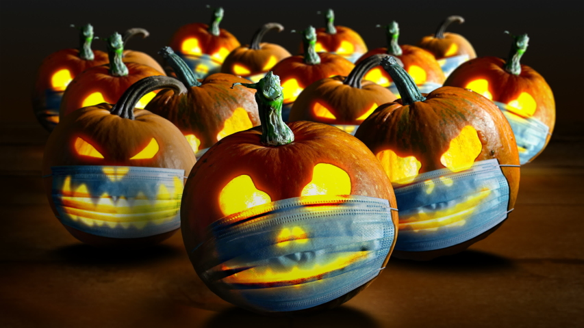 Halloween pumpkins in a protective medical face masks Second wave of coronavirus infection in autumn. New normal concept. Halloween and Covid-19 concept. | Shutterstock HD Video #1058231347