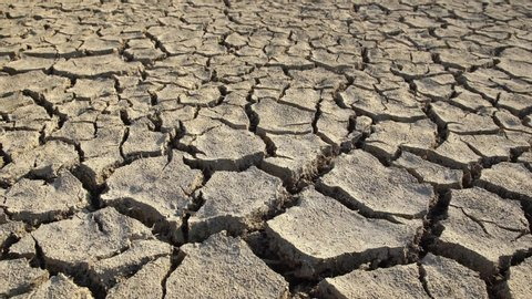 Dried and cracked soil layers, drought on earth