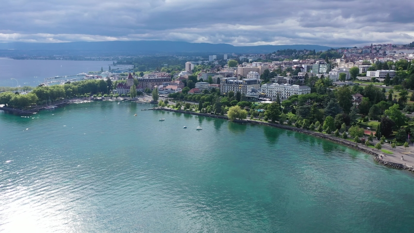 View from Lake Leman of residential areas of Swiss city of Lausanne in cloudy summer day, canton of Vaud in Romandy