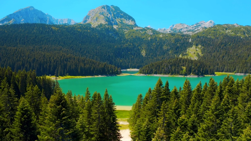 Montenegro, Durmitor area. Aerial panoramic view of the turquoise water of the Black Lake. Mount Durmitor on the background