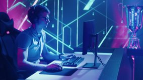 Two Professional Esport Gamers Compete in a Video Game Playing on a Championship Event and Stylish Neon Arena. Online Streaming Cyber Gaming Tournament. Zoom in Descending Crane Portrait Camera Shot