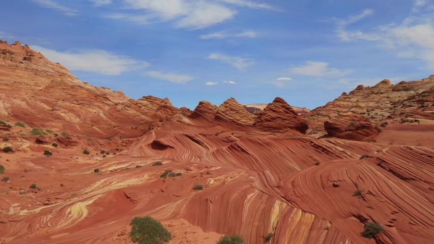 Drone Flight Through a Wild Desert Landscape Coyote Buttes / Vermillion Cliffs Wilderness Area with Strange Hoodoos and Navajo Sandstone