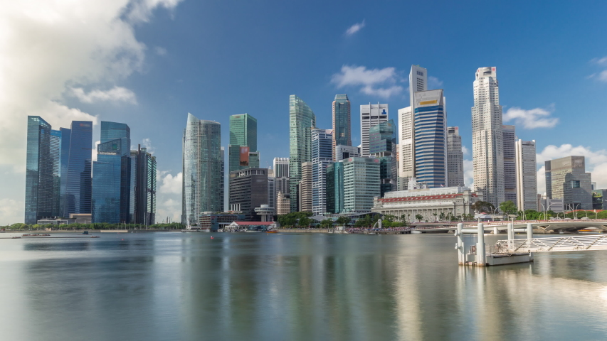 Business Financial Downtown City and Skyscrapers Tower Building at Marina Bay timelapse hyperlapse, Singapore, Cityscape Urban Landmark and Business Finance District Center reflected in water | Shutterstock HD Video #1058319484