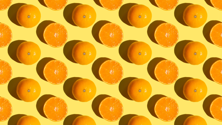 Stop motion Cut and whole tangerines alternate from left to right over orange background Royalty-Free Stock Footage #1058321014