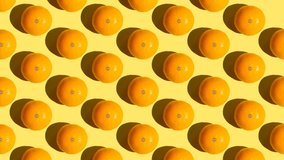 Stop motion Cut and whole tangerines appear and disappear diagonally on an orange background