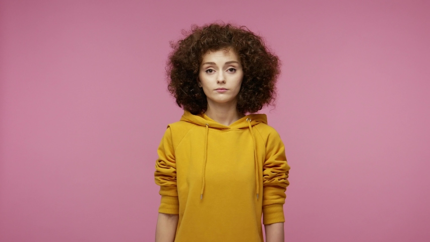 I'm the best! Selfish haughty young woman afro hairstyle in hoodie pointing herself, looking at camera with arrogance superiority, bragging own success. indoor studio shot isolated on pink background | Shutterstock HD Video #1058324971
