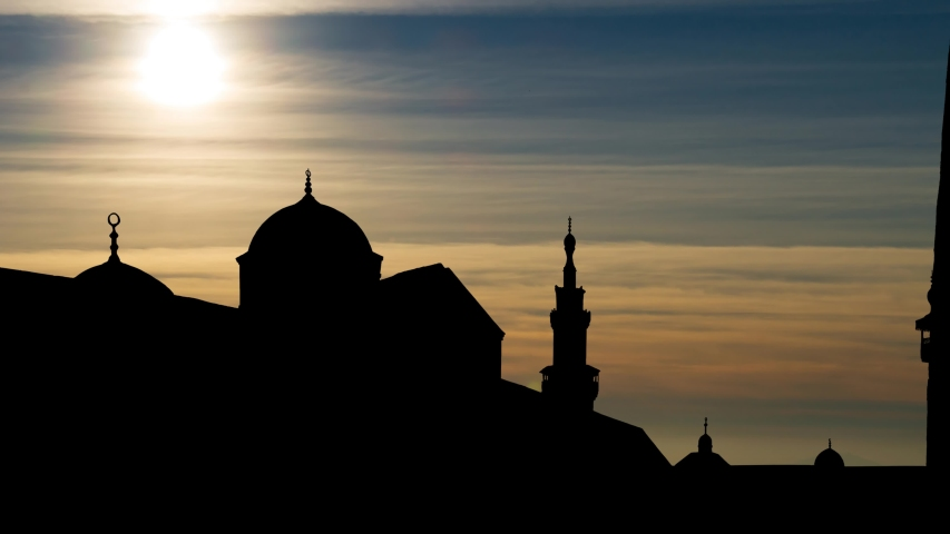 Time Lapse at Sunset with The Umayyad Mosque or Great Mosque of Damascus in Silhouette, one of the largest and oldest mosques in the world | Shutterstock HD Video #1058331115