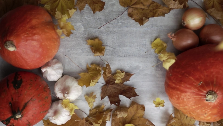 Dry leaves falling on an autumn still life of vegetables in slow motion top view. Theme of fall ecology harvest and thanksgiving day holiday. Composition with space for text of group of ripe veggie. | Shutterstock HD Video #1058336098