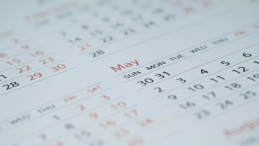 Close up of white color calendar on table, Royalty-Free Stock Footage #1058349031