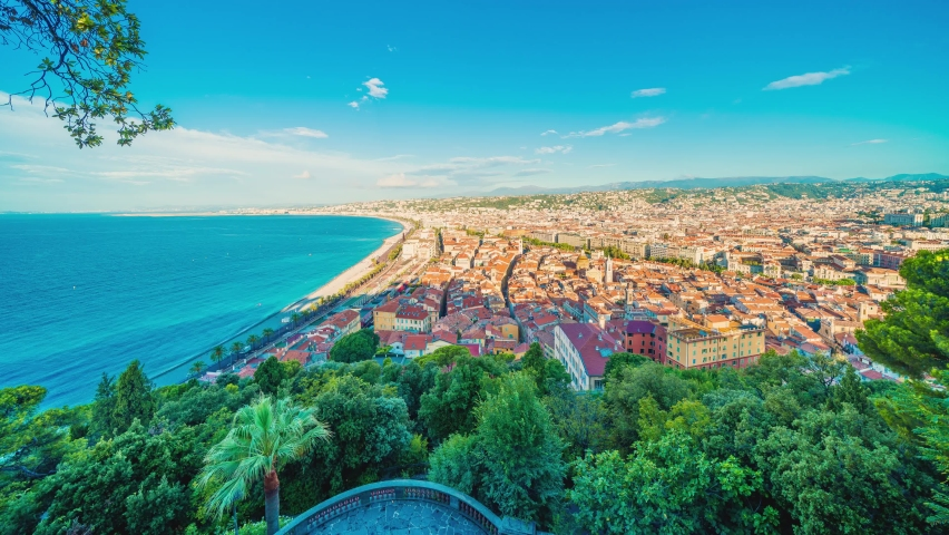 4K timelapse of Nice city,Cote d'Azur,France.Aerial view of Nice city and luxury resort of French riviera, sunrise in a sunny summer day.Famous tourist destination with nice beach on Mediterranean sea