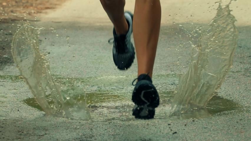 Runner Fit Athlete Legs Sport Jogging For Triathlon.Triathlete Running,Sprinting And Endurance Marathon Workout.Running Man On Puddle.Sport Recreation Fitness Training.Runner Jog Exercising Outdoors. Royalty-Free Stock Footage #1058360146