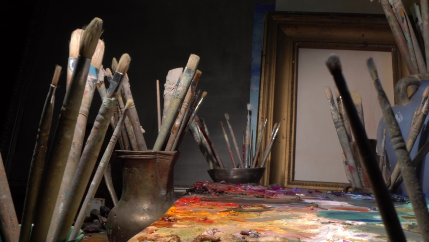 Artist's art workshop. Art Tools for Artist, Sculptor, and Architect. Brushes, paints, palette, canvas, easel