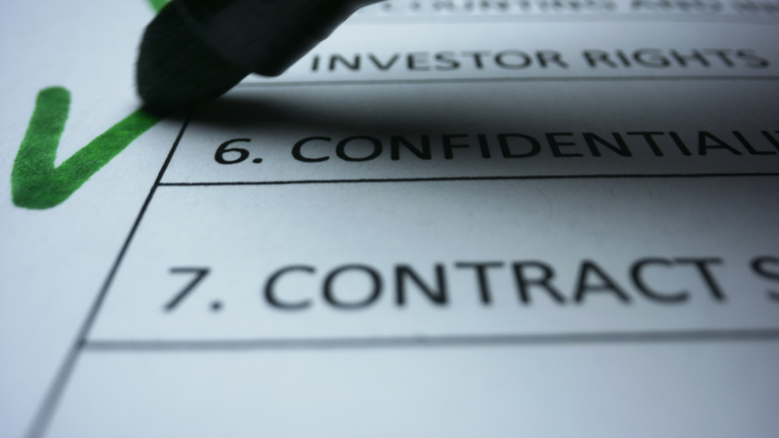 Macro shot business person filling up to do list. Green marker writing check marks in financial document. Close up checklist document of finished work duties. Checking marks on business document | Shutterstock HD Video #1058371156