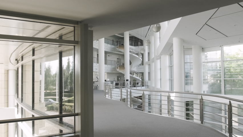 Empty modern corporate business office lobby - steadycam Royalty-Free Stock Footage #1058373511