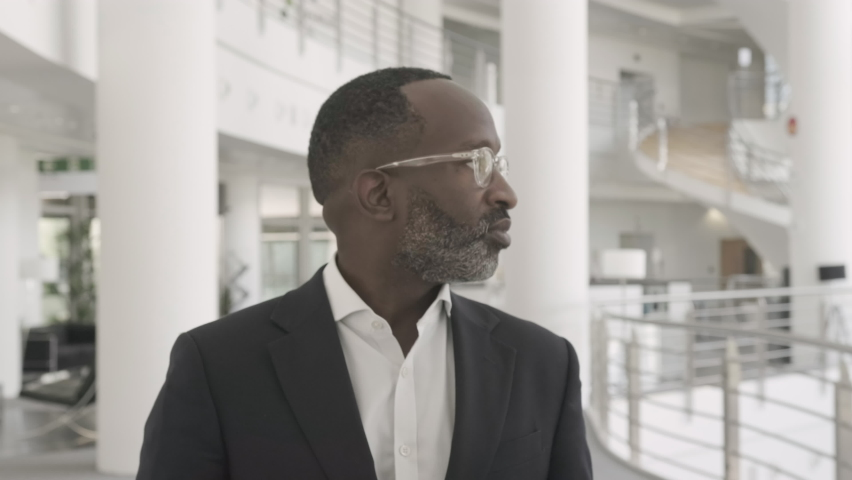 Successful Black Business man executive walking in modern office lobby and looking into camera confident Royalty-Free Stock Footage #1058373664