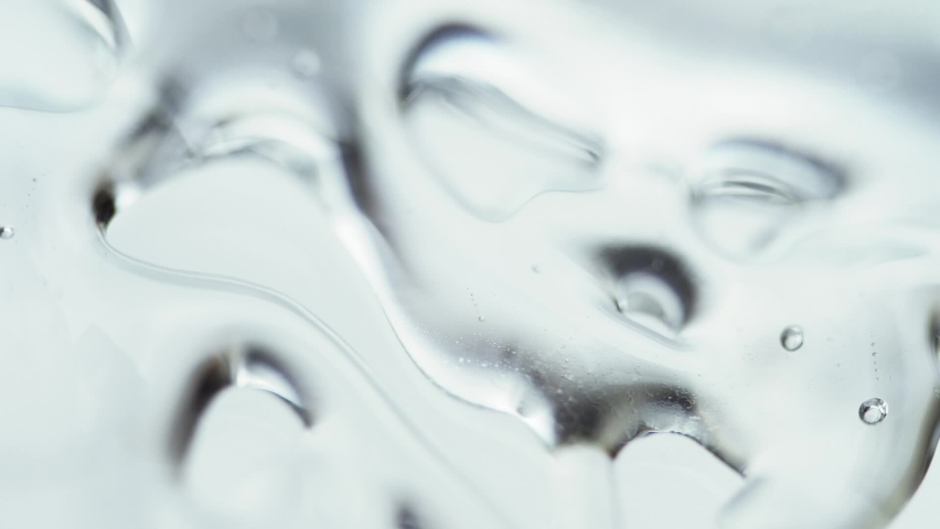 Liquid Gel Cream With Micro Bubbles Moving In Glass. - macro shot | Shutterstock HD Video #1058382061