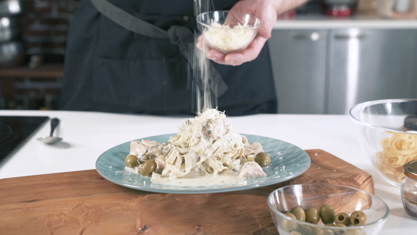Chef Sprinkles Pasta With Cheese. Cooking Delicious Food In Restaurant Kitchen. Gourmet Meal Food Recipe. Food Preparation. Cook Making Dinner In Italian Cuisine Eatery. Gastronomy Culinary. | Shutterstock HD Video #1058383447