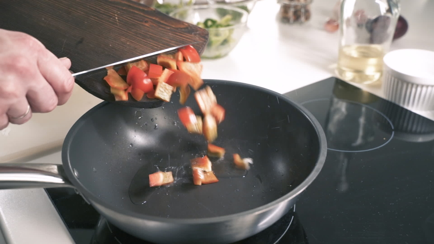 Chef Puts Vegetables In Frying Pan. Cooking Delicious Food In Restaurant Kitchen. Gourmet Meal Food Recipe. Food Preparation. Cook Making Dinner In Italian Cuisine Eatery. Catering Kitchen. | Shutterstock HD Video #1058383456