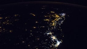 ISS Time-lapse Video of Earth seen from the International Space Station with dark sky and city lights at night over Nile , Time Lapse 1080p. Images courtesy of NASA. Pan up motion timelapse