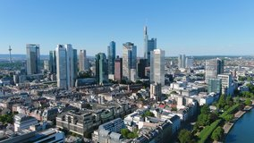 Aerial view of city skyline of Frankfurt am Main, cityscape with modern buildings (skyscrapers) with clear blue sky behind them - landscape panorama of Germany from above, Europe