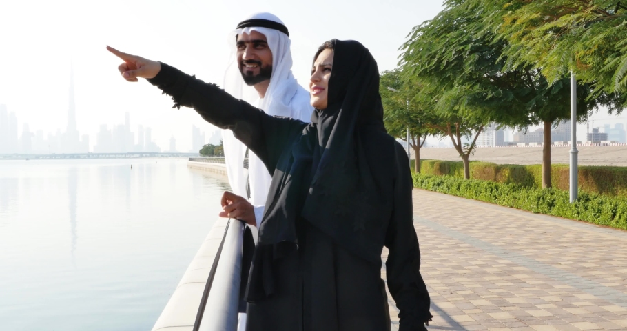 Happy couple spending time in Dubai. Young man and woman wearing uae traditional clothes