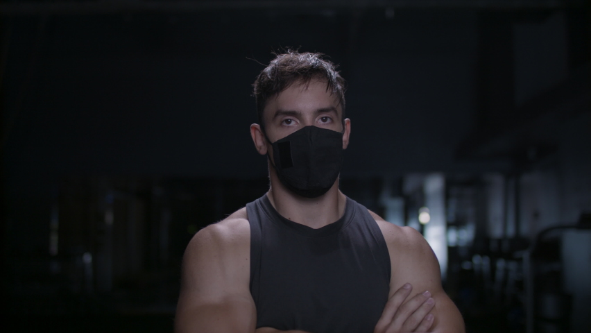 Strong and powerful portrait of a diverse athlete in a mask. Focused on achieving his goals. There is nothing Impossible. Shot in 4k.   | Shutterstock HD Video #1058431975