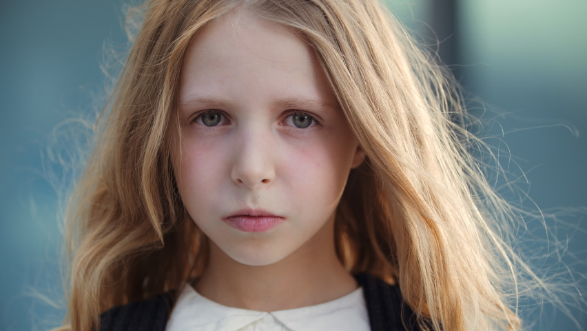 Portrait of upset sleepy little schoolgirl looking at camera with sadness and resentment in her eyes, lonely kid cute lady crying, wiping tear from her face with child hand, negative bad mood concept | Shutterstock HD Video #1058439871