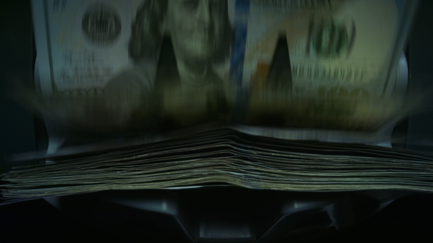 Overhead view currency counting machine counting dollar banknotes. Cash money counting equipment. Closeup US money banknotes of new 100 dollars. Currency exchange of one hundred usd in bank office | Shutterstock HD Video #1058447281