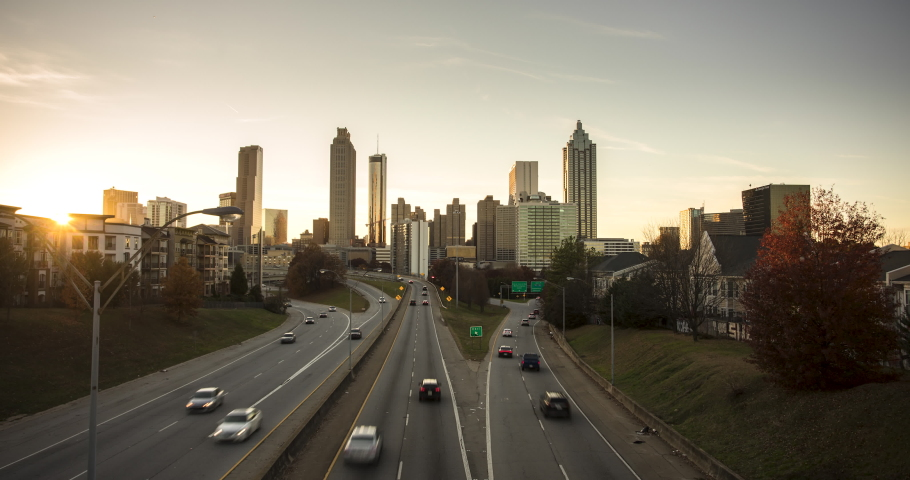 Atlanta skyline changing from day to night and traffic flowing