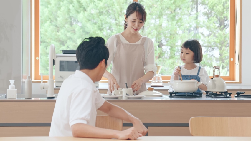 Family cooking in the kitchen. Royalty-Free Stock Footage #1058464255