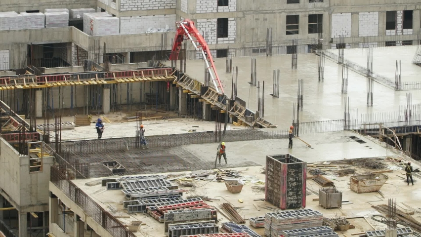 Time lapse of workers at large construction site pour and level concrete. Advanced building technology and modern monolithic construction. Сonstruction industry