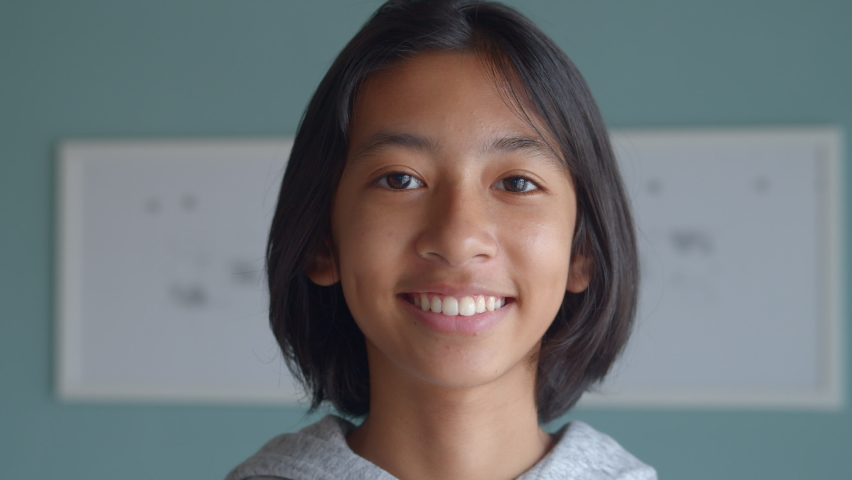 Medium close up. Portrait of Asian girl happy and smiling on face confident and looking to camera at home morning | Shutterstock HD Video #1058472643