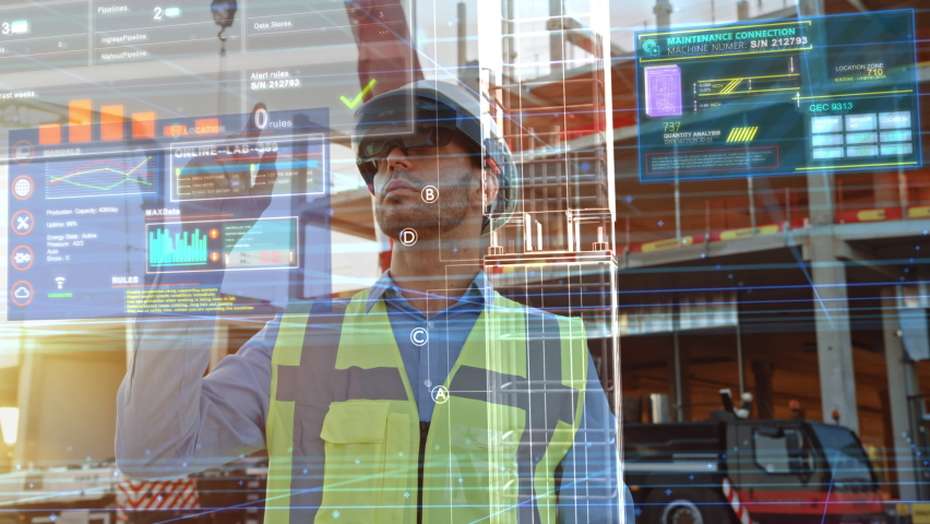 Futuristic Architectural Engineer Wearing Augmented Reality Headset, Uses Gestures to Create 3D Graphics VFX Model of a Building with Infographics. In Background Construction Site in Progress | Shutterstock HD Video #1058475670