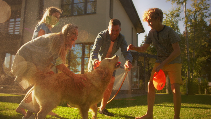 Father, Daughter, Son Play With Loyal Golden Retriever, Dog Tries to Catch Water from Garden Water Hose. Smiling Family Spending Fun Outdoors Time Together in Backyard. Golden Hour Sunset. Slow Motion | Shutterstock HD Video #1058475679