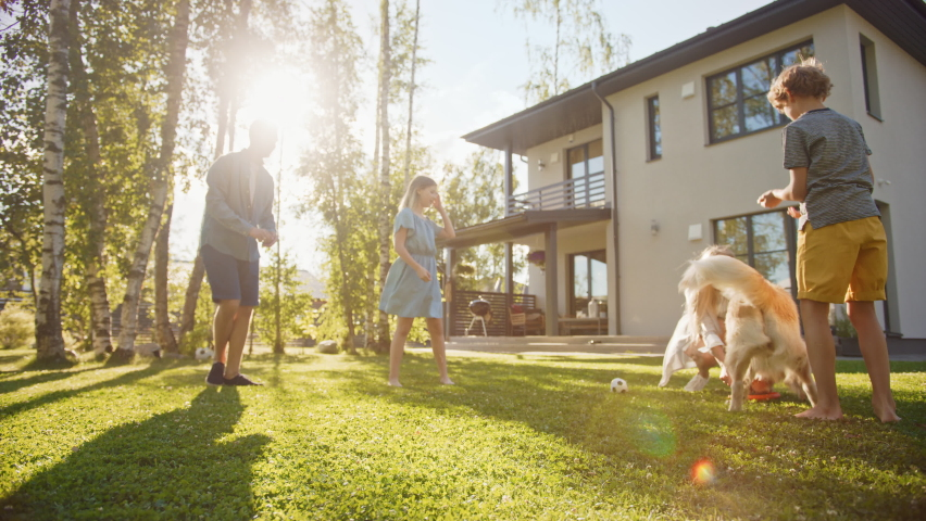 Smiling Beautiful Family of Four Play Catch flying disc with Happy Golden Retriever Dog on the Backyard Lawn. Idyllic Family Has Fun with Loyal Pedigree Dog Outdoors in Summer House. Handheld Low Shot | Shutterstock HD Video #1058475688
